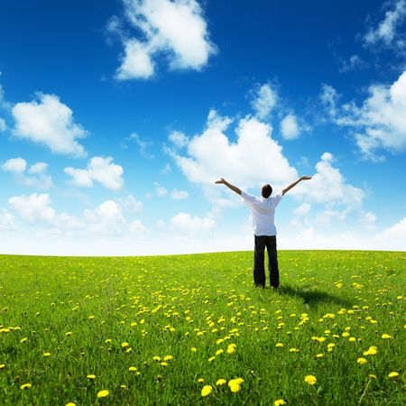 field of grass and happy young man Stock Photo - 6714611