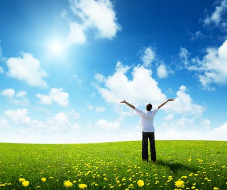 field of grass and happy young man Stock Photo