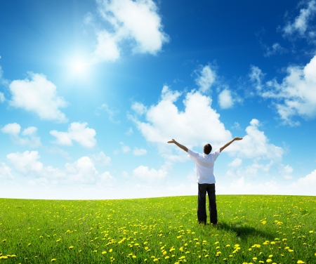 freedom: field of grass and happy young man Stock Photo