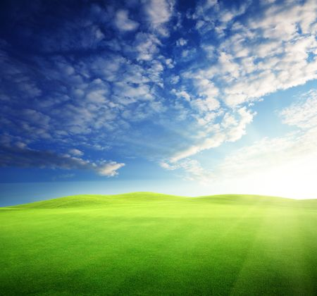 field of grass and perfect sunset sky Stock Photo - 6777703