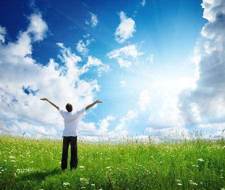 field of grass and happy young man Stock Photo - 6777017