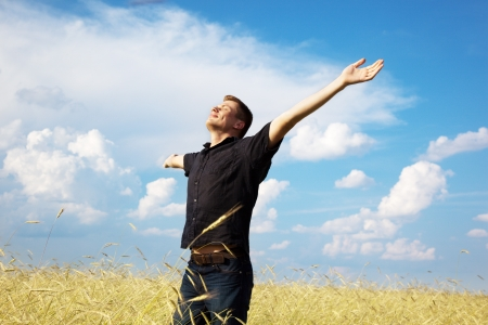 young man rest on wheat field Stock Photo - 7682057