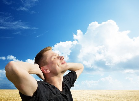 joy of life: young man rest on wheat field Stock Photo