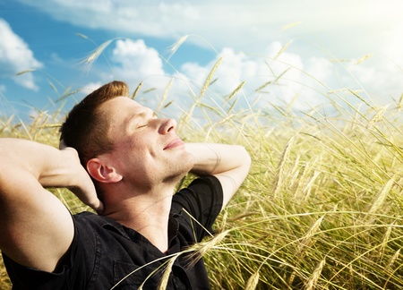 young man rest on wheat field photo