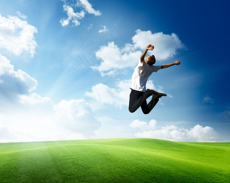 jumping happy young man Stock Photo - 8347197