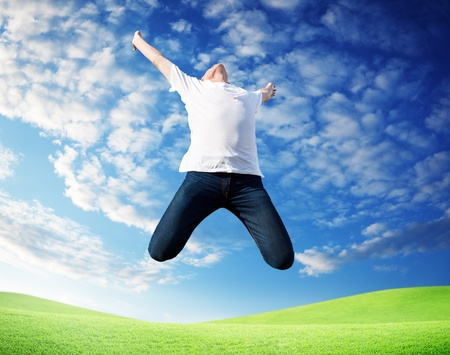 jumping happy young man Stock Photo - 8347155