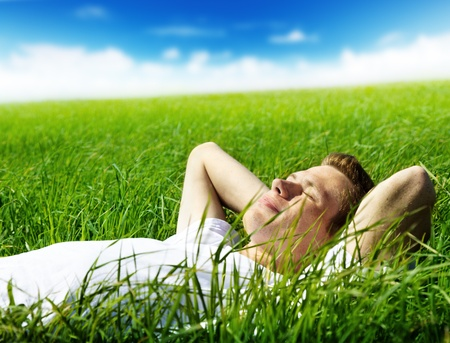 resting: young man in spring grass