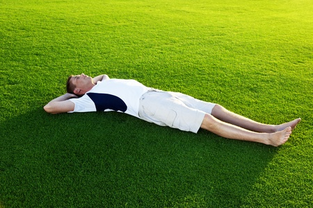 young man relax on spring grass photo