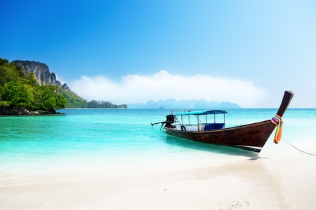 thailand view: long boat and poda island in Thailand