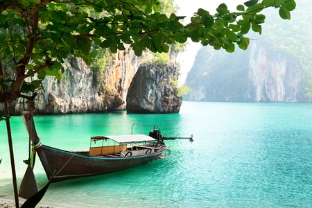 sea scenery: long boat on island in Thailand