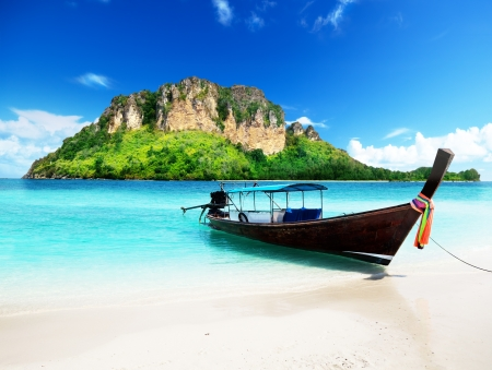 long boat and poda island in Thailand photo