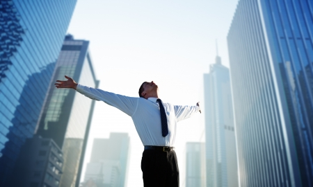 happy young businessman and big city Stock Photo - 10120603