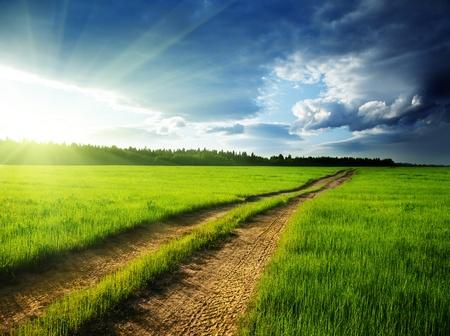 地面の道および日没 写真素材 - 10120695
