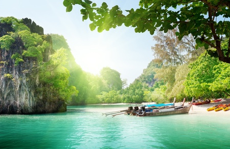 long boats on island in Thailand 写真素材