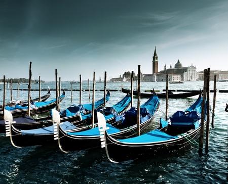 Gondolas on Grand Canal and San Giorgio Maggiore church in Venice photo
