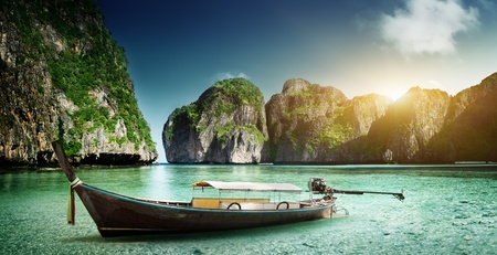 boat on sand of Maya bay Phi phi island photo