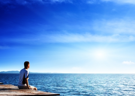 young man relax siting on pier  Stock Photo - 14633174