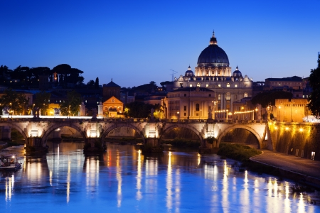 pietro: Sant Angelo Bridge and Basilica of St. Peter in Rome, Italy Stock Photo