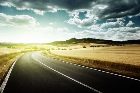 landscape: asphalt road in Tuscany Italy