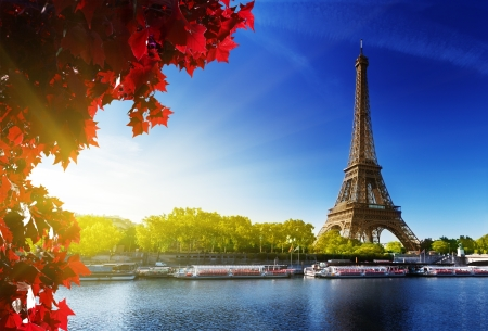 Seine in Paris with Eiffel tower in autumn time photo