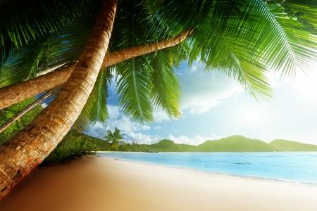 indian summer: sunset on beach Anse Takamaka of Mahe island, seychelles Stock Photo