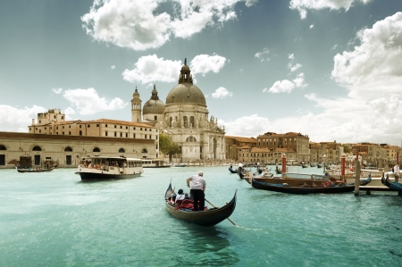 canals: Grand Canal and Basilica Santa Maria della Salute, Venice, Italy and sunny day