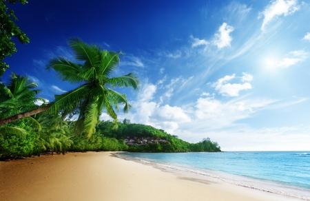 anse: sunset on beach Anse Takamaka of Mahe island, seychelles Stock Photo