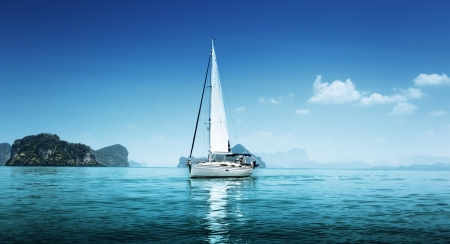 yacht and blue water ocean photo