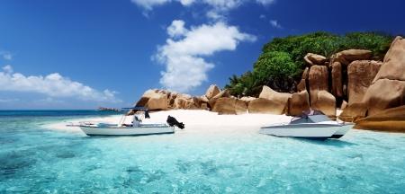 seychelles: speed boat on the beach of Coco Island, Seychelles