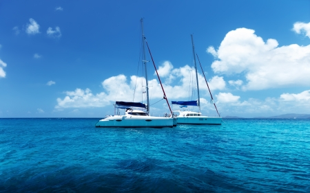 Yacht Sailing on water of ocean photo