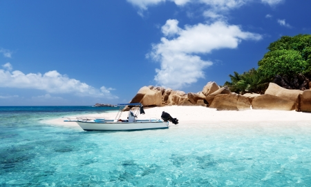 speed boat: speed boat on the beach of Coco Island, Seychelles