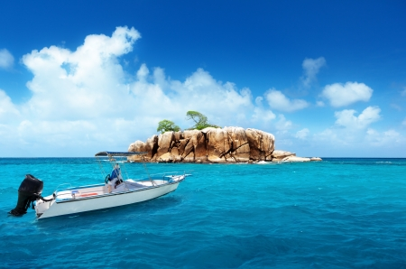 speed boat and island at Seychelles photo