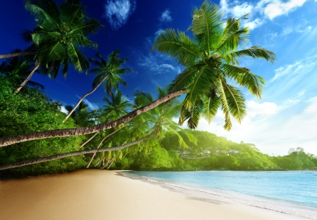 seychelles: sunset on beach Anse Takamaka of Mahe island, seychelles Stock Photo