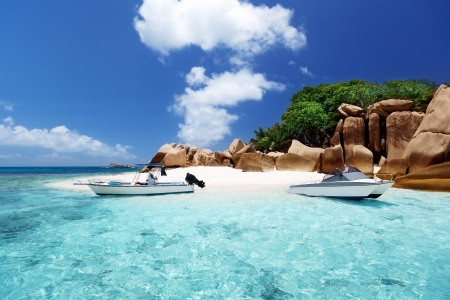 speed boat on the beach of Coco Island, Seychelles photo