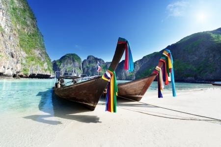 boats at Maya bay Phi Phi Leh island, Thailand photo