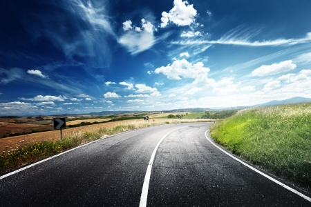 country road: asphalt road in Tuscany Italy