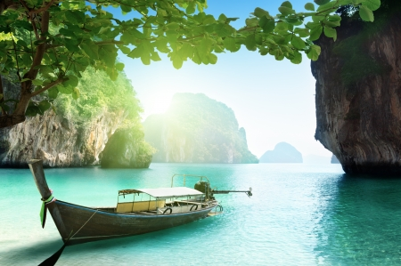 boat on beach of island in Krabi Province, Thailand photo