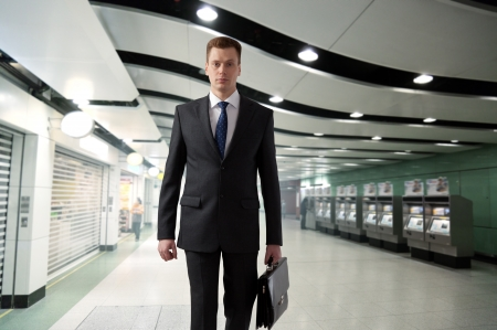 business man walking in subway photo