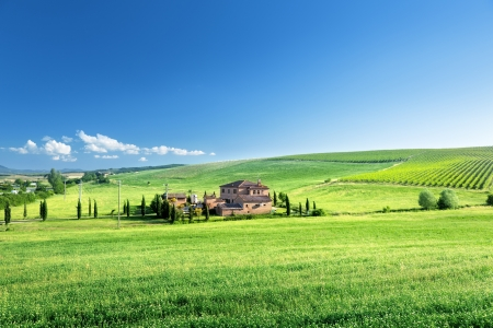 Tuscany landscape with typical farm house, Italty photo