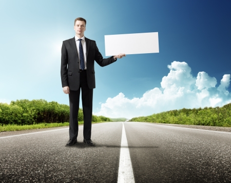 business man on the road with blank in hand Stock Photo - 18916223