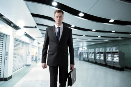 sub station: business man walking in subway