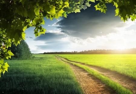 grond weg-en zonsondergang Stockfoto