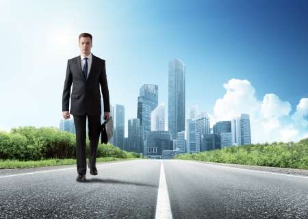business man walking on the road photo
