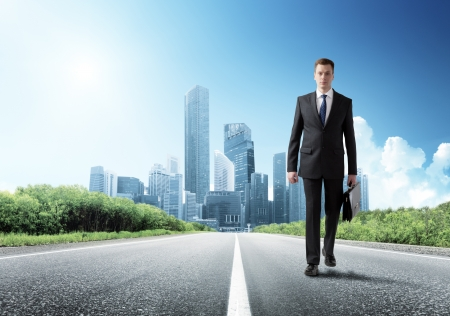 business man walking on the road Stock Photo - 19386074