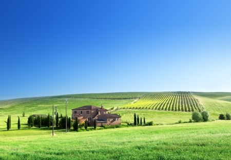 tuscan house: Tuscany landscape with typical farm house Stock Photo