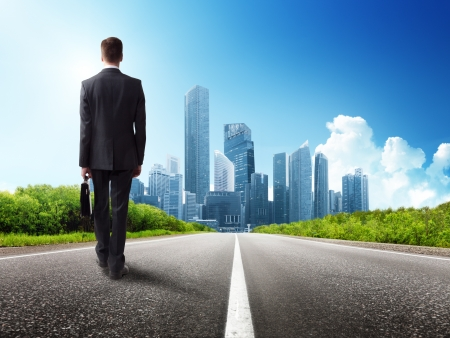 road to success: business man walking on the road Stock Photo