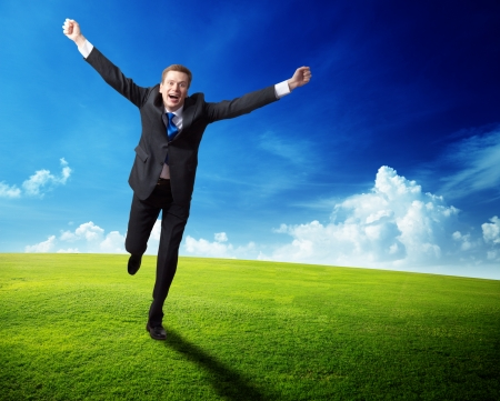 happy business man running on spring field photo