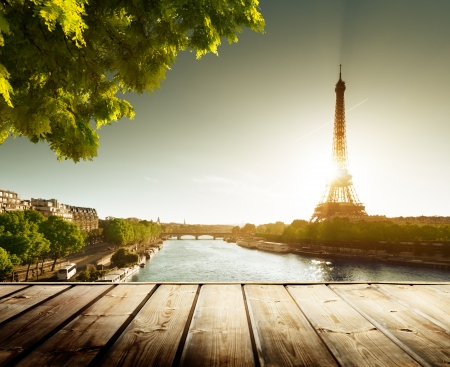 background with wooden deck table and  Eiffel tower in Paris photo