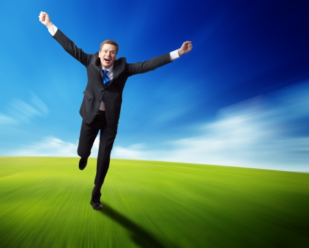 happy business man running on blured spring field photo