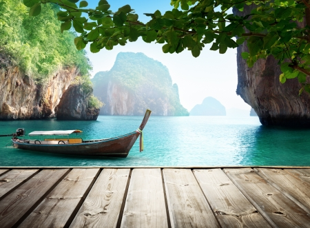 island: Adaman sea and wooden boat in Thailand Stock Photo